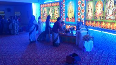 Offering of flowers at the Sacred Padukas of Gurudev, Sri Swami Sivananda