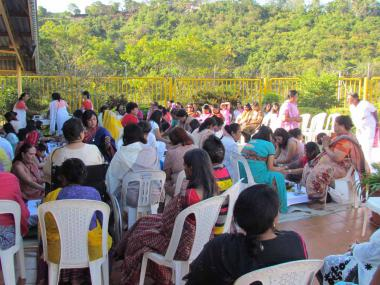 Devotees participating in the Havan