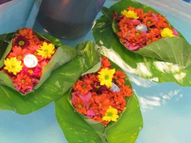 Flower boats are offered to Ganga Mata for the peace of the Departed Souls