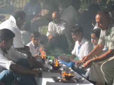 Devotees participating in the Havan